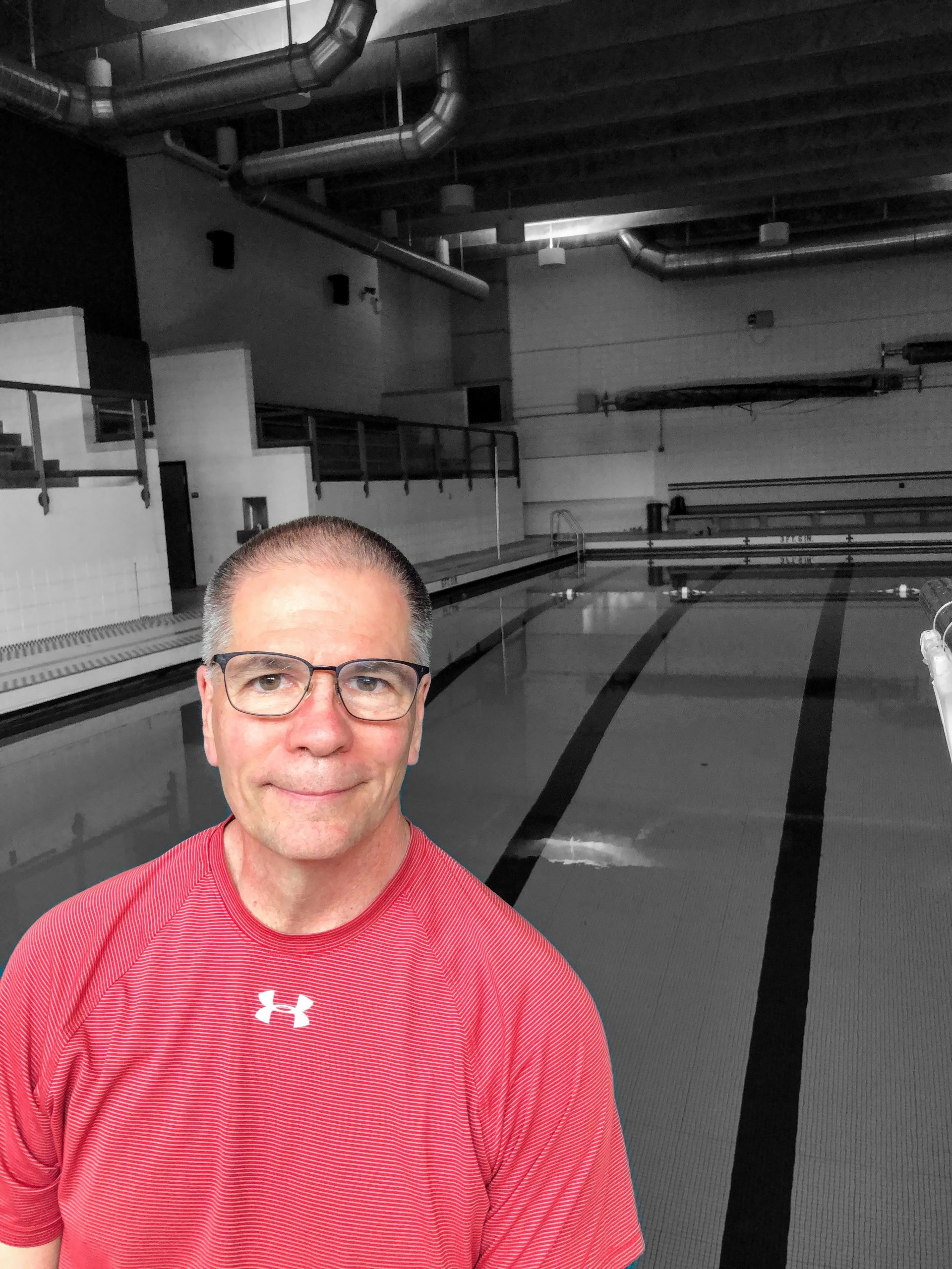 Mark Rauterkus sitting at the swim pool at PPS Perry